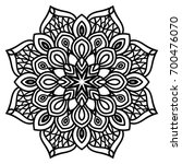 ornamental round doodle flower... | Shutterstock .eps vector #700476070
