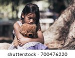 adorable sad girl with teddy... | Shutterstock . vector #700476220