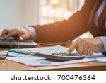 a businessman analyzing... | Shutterstock . vector #700476364