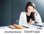 happy business woman working... | Shutterstock . vector #700497268