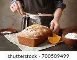 woman covering delicious citrus ... | Shutterstock . vector #700509499
