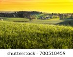 small village in alps at sunset....   Shutterstock . vector #700510459