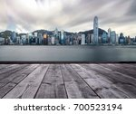 wood floor and hong kong city... | Shutterstock . vector #700523194