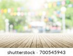 empty wooden table with party... | Shutterstock . vector #700545943