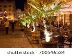 night city street with cafes... | Shutterstock . vector #700546534