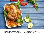 baking dish with golden roasted ... | Shutterstock . vector #700549213