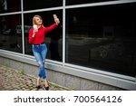 portrait of a beautiful woman... | Shutterstock . vector #700564126