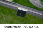 aerial top view of white truck... | Shutterstock . vector #700565716