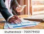 business women holding pencils... | Shutterstock . vector #700579453