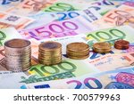 banknotes and euro coins | Shutterstock . vector #700579963