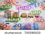 banknotes and euro coins | Shutterstock . vector #700580020