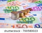 banknotes and euro coins | Shutterstock . vector #700580023