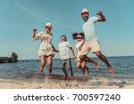 happy african american family... | Shutterstock . vector #700597240