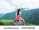 hiking woman sitting on top... | Shutterstock . vector #700598098