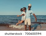 happy african american father... | Shutterstock . vector #700600594
