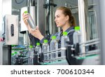worker at a water factory | Shutterstock . vector #700610344