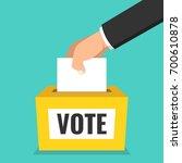 voting concept. hand putting...   Shutterstock .eps vector #700610878