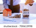 businessmen collect money to... | Shutterstock . vector #700613998