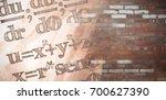 Small photo of Digital composite image of algebraic formulas against brick wall