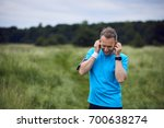cheerful mature man listening... | Shutterstock . vector #700638274