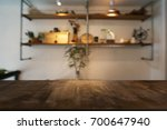 empty wooden table in front of... | Shutterstock . vector #700647940