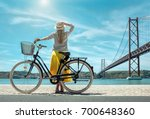 blonde woman in summer hat and... | Shutterstock . vector #700648360