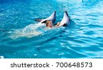 Happy Child And Dolphins In...