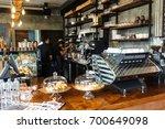 barista cafe making coffee... | Shutterstock . vector #700649098