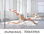 young sexy pole dance woman... | Shutterstock . vector #700653964
