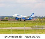 Small photo of Stuttgart, Germany - April 29, 2017: Airbus airplane from Ellinair during offtake - green meadow with fence in front