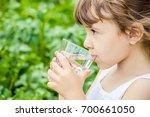child drinks water. selective... | Shutterstock . vector #700661050