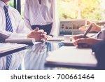 businesspeople present business ... | Shutterstock . vector #700661464