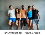 smiling group of friends in... | Shutterstock . vector #700667086