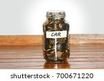 a glass jar full of coins to... | Shutterstock . vector #700671220