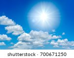 sun in blue sky with clouds. | Shutterstock . vector #700671250