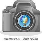 slr camera on a white... | Shutterstock .eps vector #700672933