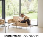 handsome casual young man using ... | Shutterstock . vector #700700944