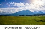 mountain valley with houses ... | Shutterstock . vector #700703344