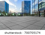 empty pavement and modern... | Shutterstock . vector #700705174