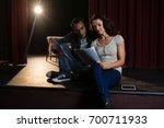 actors reading their scripts on ... | Shutterstock . vector #700711933