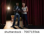 actors reading their scripts on ... | Shutterstock . vector #700715566