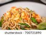 Small photo of Fried noodle mixed with bean sprout, Allium ramosum, roasted peanuts and some meat such as shrimp is called in PAD THAI