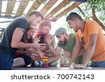 friends playing block game  | Shutterstock . vector #700742143