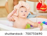 funny baby girl in a bath hat... | Shutterstock . vector #700753690