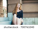 young blonde woman sitting on...   Shutterstock . vector #700761040