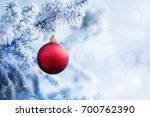 red christmas ball hanging on a ... | Shutterstock . vector #700762390