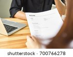 young woman submit resume to... | Shutterstock . vector #700766278