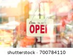 open sign broad through the... | Shutterstock . vector #700784110