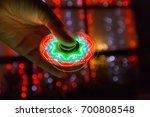 girl playing with a tri fidget... | Shutterstock . vector #700808548