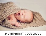newborn baby boy wrapped in a... | Shutterstock . vector #700810330